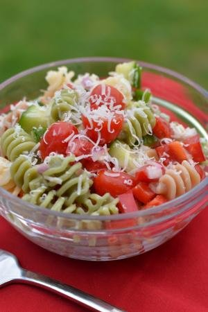 Italian Pasta Salad in a bowl with a fork besides it