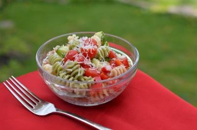 A bowl of Italian Pasta Salad with a fork besides it