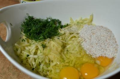 Zucchini dill, eggs, salt in bowl