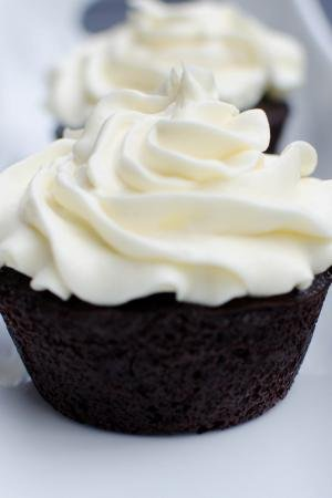 Creamy Chocolate Cupcakes in a row on a long plate