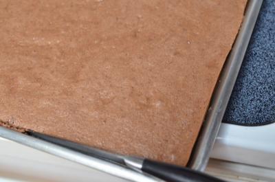 Chocolate Drunken Cherry Roll dough on a baking sheet