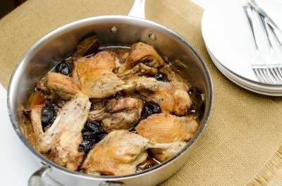 A pan with Roasted Duck with Prunes