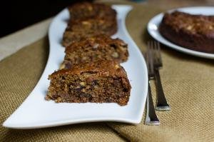 Fruit & Prune Lumberjack Cake slices in a row on a long plate