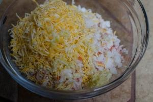 A mixture of cheese, crab and garlic in a bowl