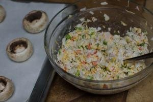 A mixture of cheese, crab, garlic, green onion and mayonnaise in a bowl