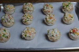 Crab Stuffed Mushrooms being placed on a baking sheet