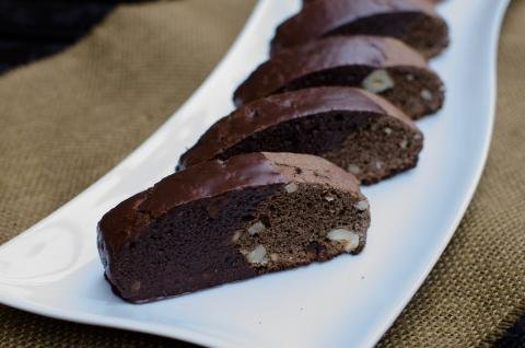 Hazelnut Triple Chocolate Biscotti in a row on a plate