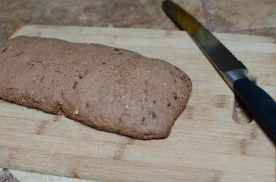 Baked Hazelnut Triple Chocolate Biscotti dough on a cutting board