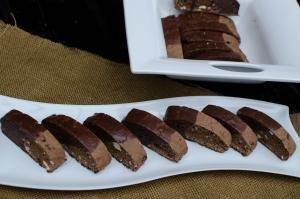 Hazelnut Triple Chocolate Biscotti in a row on a plate