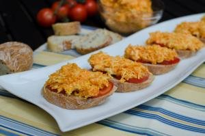 Carrot Cheesy Sandwiches in a row on a long plate