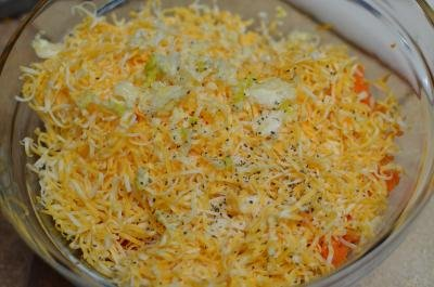 In a bowl grated cheese, garlic, mayo and carrots are mixed together