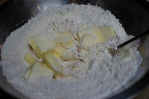 A mixture of butter, flour, and yeast in a bowl