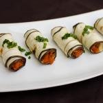 Eggplant Roll Up Appetizer in a row on a plate