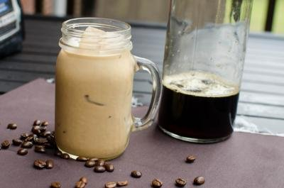 Cold-Brew Coffee with coffee beans around the bottom of the cup
