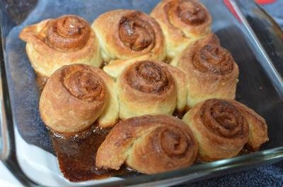 A pan filled with rolled and baked cinnamon rolls