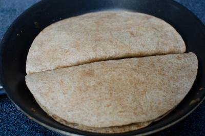 Quesadillas on a skillet being fried