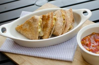Breakfast Quesadillas in a bowl cut into fourths with salsa on the side