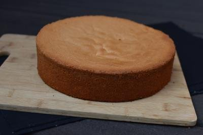 A full sponge cake on a board