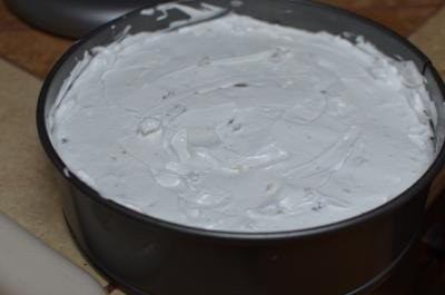 Mixture of whipped sugar, egg whites and hazelnuts placed into a baking sheet that is lined with parchment paper