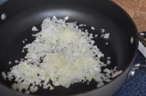 Diced onions on a skillet for Zuppa Toscana Soup Recipe