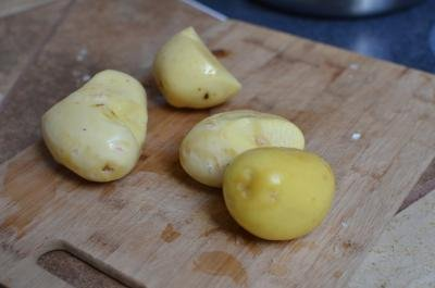 Peeled and clean potatoes on a cutting board