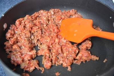 Crumbled sausage in a skillet