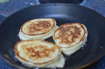 Russian Pancakes Oladi in a frying pan
