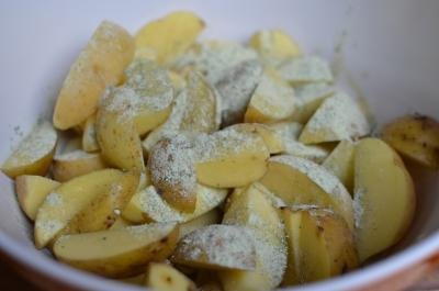Cut potatoes in a bowl with the ranch salad mix sprinkled on top
