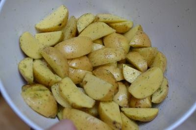 Potatoes getting tossed in the ranch salad dressing mix