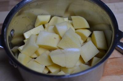 Potatoes in a pot with salt