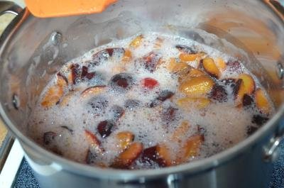 Prunes bing boiled in a pot over the stove top