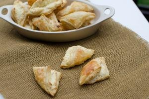 Puff Pastry Cheese Turnovers in a bowl and on the table