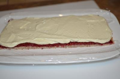 Layers laid out on a plate dough, raspberry jam, and cream