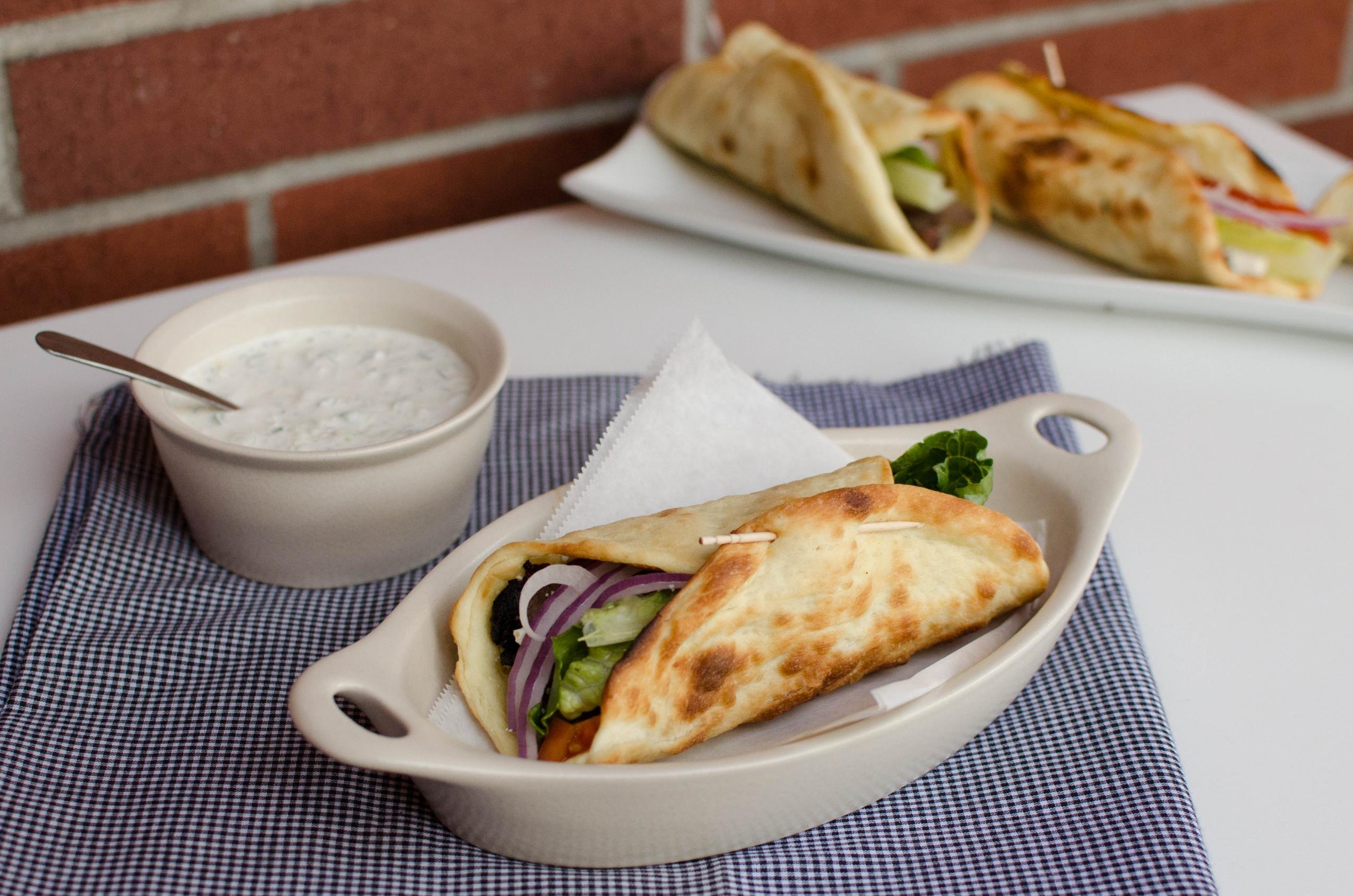 Gyro and Tzatziki Sauce on a table