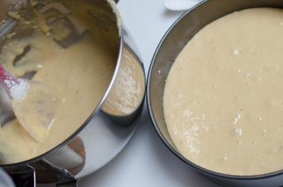 Cake batter being placed into a cake pan