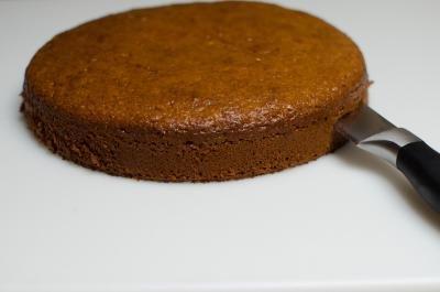 Cake layer being cut into half horizontally