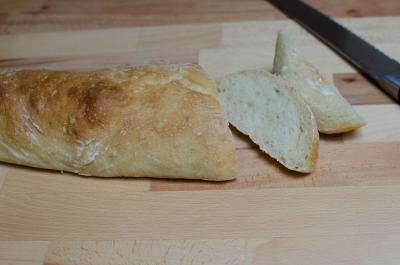 Baguette being sliced into 1.5inch wide slices