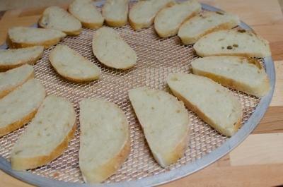 Baguette sliced placed on baking sheet