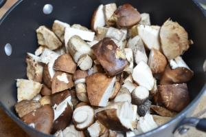 Mushrooms cut into pieces and placed into a pot