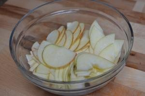 Apples in a bowl sliced into thin slices