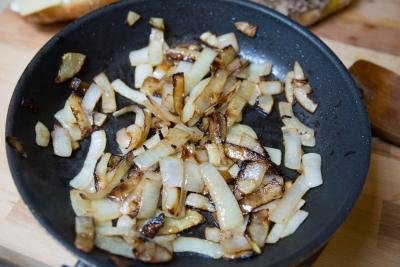 onions being sautéed in a skillet