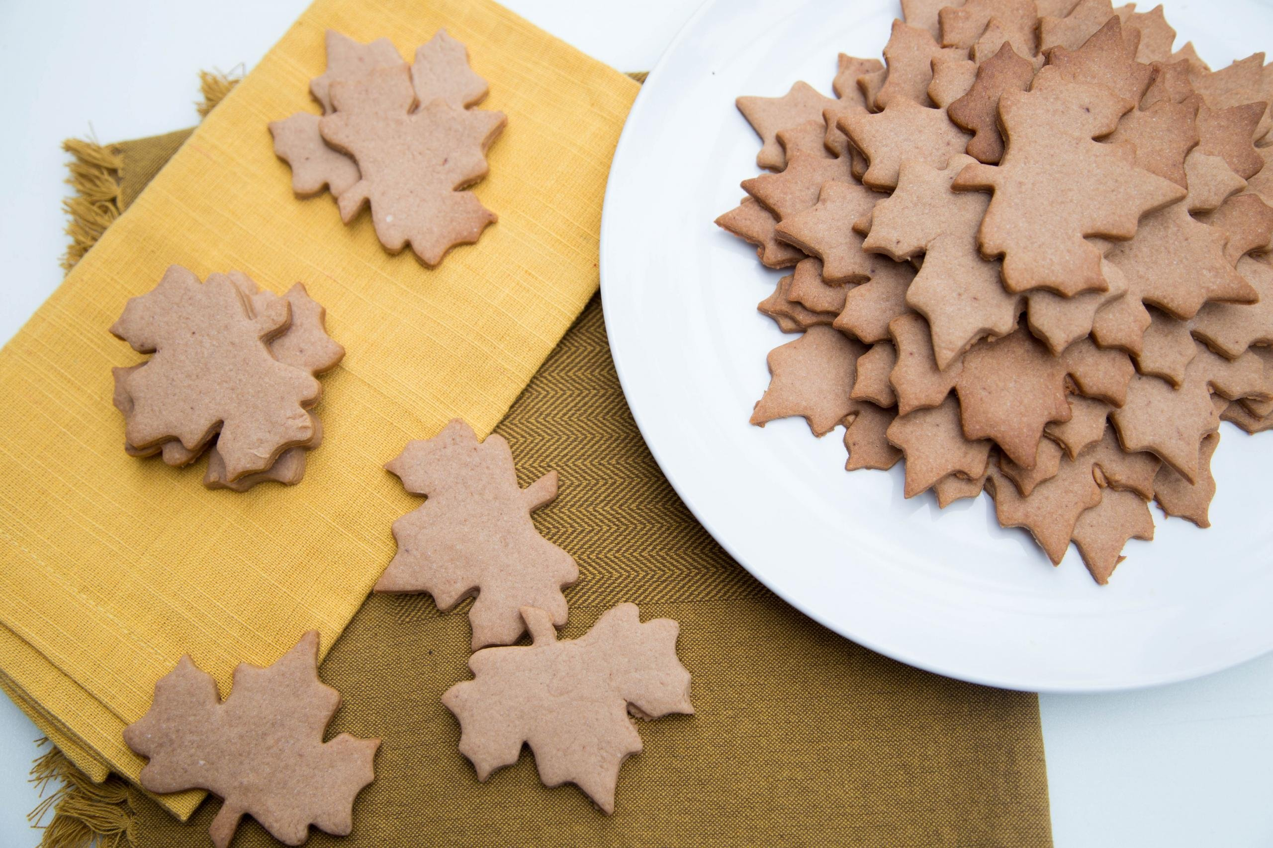 Leaf shaped cookies on a plate and on table napkins