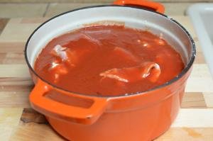 Tomato sauce mixture poured over the veggies and fish in the dutch oven