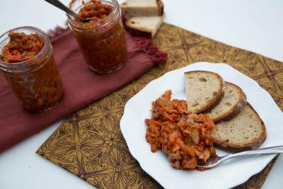 Russian Canned Fish in Tomato Sauce next to 3 slices of bread on a plate