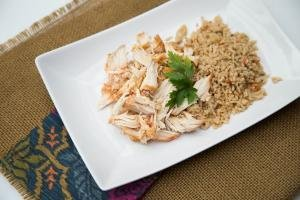 Mexican Crock Pot Chicken on a plate with rice next to it