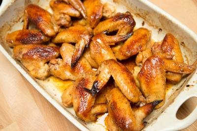 Easy Glazed Chicken Wings in a ceramic baking dish