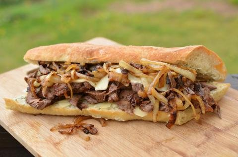 Steak Sandwich on a cutting board