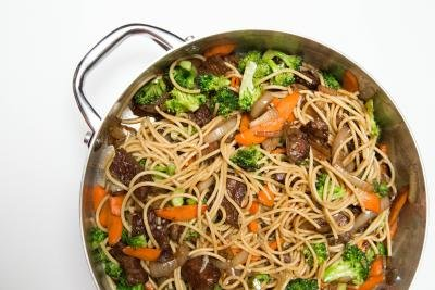 Veggies, beef and spaghetti are all mixed together