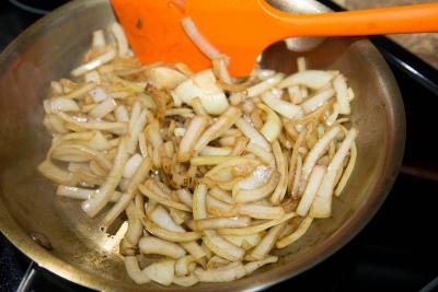 Onions being sautéed on a skillet