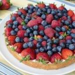 A full fruit tart on a plate